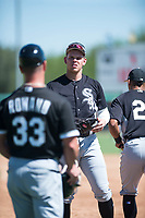 Chicago White Sox first baseman Corey Zangari (25) talks to coach Aaron Rowand (33) between innings of an Instructional League game against the Kansas City Royals at Camelback Ranch on September 25, 2018 in Glendale, Arizona. (Zachary Lucy/Four Seam Images)
