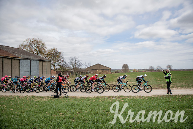 Leading bunch crossing the Plugstreets gravel roads with Team BikeExchange setting the pace<br /> <br /> 83rd Gent-Wevelgem - in Flanders Fields (ME - 1.UWT)<br /> 1 day race from Ieper to Wevelgem (BEL): 254km<br /> <br /> ©kramon