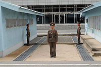 "North Korean soldiers guard the demilitarized zone (DMZ) at Panmunjom, North Korea. The DPRK (Democratic People's Republic of Korea) is the last great dictatorship where the people are bombarded with images of the ""Eternal President"" Kim Il-sung who died in 1994 and his son and current leader Kim Jong-il who are worshipped like a God."