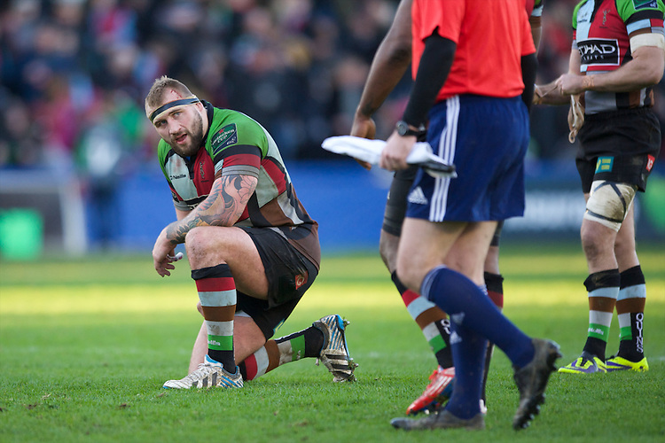 Joe Marler of Harlequins looks dejected after the final whistle during the Heineken Cup Round 5 match between Harlequins and ASM Clermont Auvergne at the Twickenham Stoop on Saturday 11th January 2014 (Photo by Rob Munro)