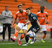 Blackpool's Jordan Lawrence-Gabriel battles with Leeds United's Oliver Casey<br /> <br /> Photographer Dave Howarth/CameraSport<br /> <br /> EFL Trophy - Northern Section - Group G - Blackpool v Leeds United U21 - Wednesday 11th November 2020 - Bloomfield Road - Blackpool<br />  <br /> World Copyright © 2020 CameraSport. All rights reserved. 43 Linden Ave. Countesthorpe. Leicester. England. LE8 5PG - Tel: +44 (0) 116 277 4147 - admin@camerasport.com - www.camerasport.com