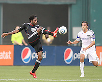 Clyde Simms #19 of D.C.United pushes the ball past Santiago Hirsig #10 of the Kansas City Wizards during an MLS match at RFK Stadium on May 5 2010, in Washington DC. United won 2-1
