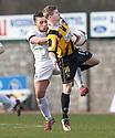 Ayr Utd's Adam Hunter goes in to thee back of East Fife's Marc McKenzie .