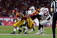 LOS ANGELES, CA - SEPTEMBER 11: Dalyn Wade-Perry #50 of the Stanford Cardinal makes a one handed tackle of Keaontay Ingram #28 of the USC Trojans during a game between University of Southern California and Stanford Football at Los Angeles Memorial Coliseum on September 11, 2021 in Los Angeles, California.