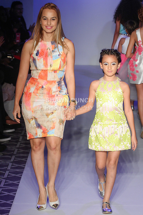 Puerto Rican fashion designer Michelle Ann, walks runway with child model at the close of her Michelle Ann Spring Summer 2016 collection fashion show, for the Designer's Collective fashion show, at Fashion Gallery NYFW Spring Summer 2016 show, during New York Fashion Week.
