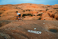 Montain biker on danger trail.