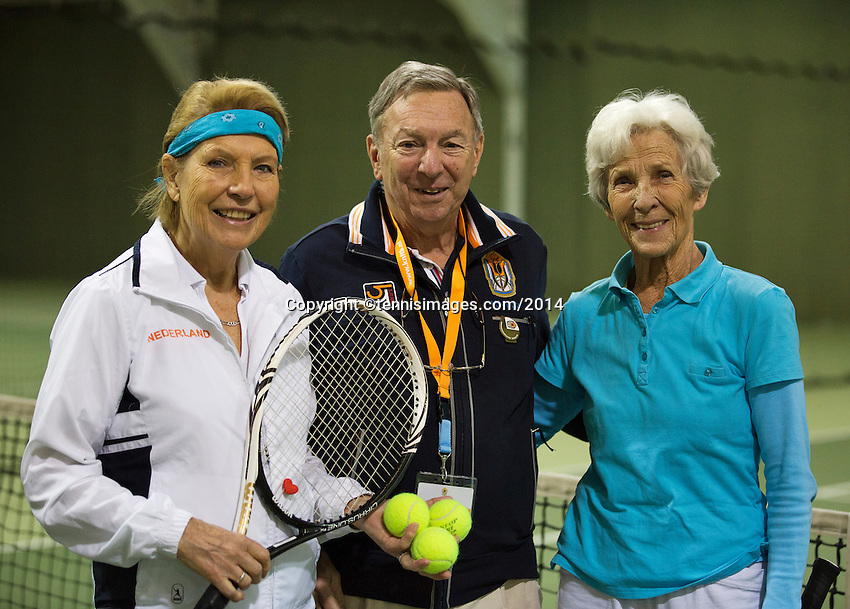 Hilversum, The Netherlands, 05.03.2014. NOVK ,National Indoor Veterans Championships of 2014, chief umpire Eric Savalle does the toss<br /> Photo:Tennisimages/Henk Koster