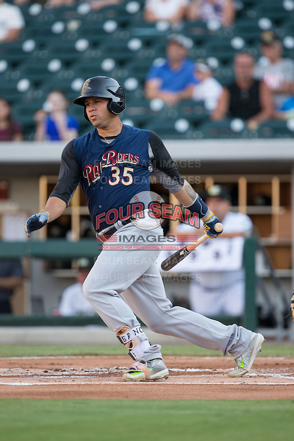Gary Sanchez (35) of the Scranton/Wilkes-Barre RailRiders follows through on his swing against the Charlotte Knights at BB&T BallPark on July 20, 2016 in Charlotte, North Carolina.  The RailRiders defeated the Knights 14-2.  (Brian Westerholt/Four Seam Images)