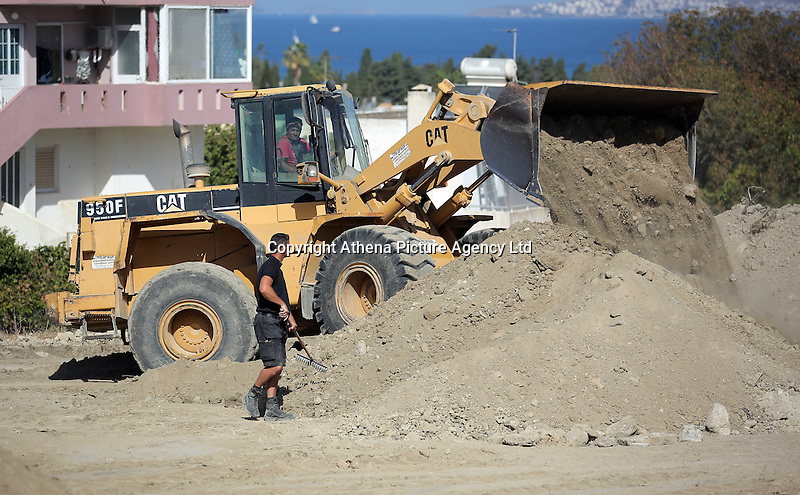 Pictured: A digger operates at the second site in Kos, Greece. Sunday 16 October 2016<br />