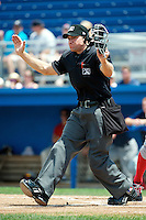 Home plate umpire J.J. Bilinski makes a call during a game between the Batavia Muckdogs and Lowell Spinners at Dwyer Stadium on July 8, 2012 in Batavia, New York.  Batavia defeated Lowell 4-2.  (Mike Janes/Four Seam Images)