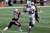 27th September 2020, Foxborough, New England, USA;  Las Vegas Raiders tight end Foster Moreau (87) makes a grab in front of New England Patriots defensive back Terrence Brooks (25) during the game between the New England Patriots and the Las Vegas Raiders