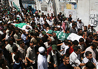 "Mourners carry the bodies of Palestinians killed by Israeli troops, during their funeral in the southern Gaza Strip, August 15, 2007. Israeli forces killed six Palestinians on Tuesday when they clashed with militants during a raid on the Hamas-controlled Gaza Strip, Palestinian militant and hospital sources said. ""photo by Fady Adwan"""