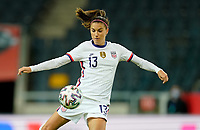 SOLNA, SWEDEN - APRIL 10: Alex Morgan #13 of the United States takes a shot during a game between Sweden and USWNT at Friends Arena on April 10, 2021 in Solna, Sweden.