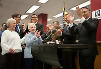 King County Executive Dow Constantine, right, leads a cheer as the clock strikes midnight and he can begin to issue marriage licenses to same-sex couples on Thursday, Dec. 6, 2012, in Seattle, Washington. First in line are Jane Abbott Lighty, 77, left, and Pete-e Petersen, 85, who have been together for 35 years. The couple are getting married on Dec 9th, the first day it is possible for same-sex couple to wed in Washington State.