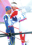 Sochi, Russia.11/03/2014. Canadian Mark Arendz congratulates Vovchynskyi Grygorii of the Ukraine after the men's 12.5km standing biathlon  at the Sochi 2014 Paralympic Winter Games in Sochi Russia. Arendz won the bronze medal(Photo Scott Grant/Canadian Paralympic Committee)