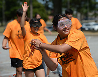 Marlene Delgado, a junior at Har-Ber High School, throws tomatoes Thursday, Sept. 9, 2021, during the Tomatina, a tomato fight with historical roots in Spain, in Murphy Park in Springdale. Advanced placement Spanish language students from Springdale and Har-Ber high schools participated in the event. Visit nwaonline.com/210910Daily/ for today's photo gallery.<br /> (NWA Democrat-Gazette/Andy Shupe)