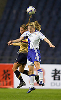 USWNT defender (3) Christie Rampone goes up for a header with Finland's (11) Linda Sallstrom during the Four Nations Tournament in  Guangzhou, China.  The US defeated Finland, 4-1.
