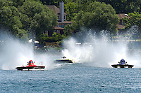 "13-14 June, 2009, APBA Inboards, Walled Lake, Novi, MI. USA.Kevin Joslyn, E-500 ""Cents Less 14"", 5 Litre hydroplane, Nicky Pellerin, E-81 ""Crazy Cajun"", 5 Litre hydroplane, E-6 ""Quantum Leap"", 5 Litre hydroplane.©F. Peirce Williams 2009 USA.F.Peirce Williams.photography.ref: RAW (.NEF) File Available"