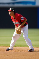 Second baseman Edwin Garcia #13 of the Hickory Crawdads on defense against the Rome Braves at  L.P. Frans Stadium May 23, 2010, in Hickory, North Carolina.  The Rome Braves defeated the Hickory Crawdads 5-1.  Photo by Brian Westerholt / Four Seam Images