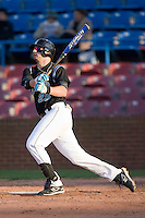David Anderson #23 of the Coastal Carolina Chanticleers follows through on his swing versus the Wake Forest Demon Deacons at Wake Forest Baseball Park April 8, 2009 in Winston-Salem, North Carolina. (Photo by Brian Westerholt / Four Seam Images)