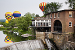 Hot air balloons float above the Ottaquechee River Dam at the Quechee Balloon Fest in Quechee, VT, USA