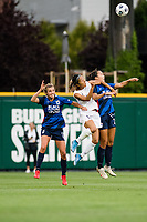 TACOMA, WA - JULY 31: Dani Weatherholt #17, Sam Hiatt #27 of the OL Reign and Yuki Nagasato #17 of Racing Louisville FC go up for a header during a game between Racing Louisville FC and OL Reign at Cheney Stadium on July 31, 2021 in Tacoma, Washington.