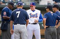 Jacksonville Suns manager John Shoemaker (12) exchanges line-up cards with the umpire and Huntsville Stars manager Don Money (7) at the Baseball Grounds in Jacksonville, FL, Thursday June 12, 2008.