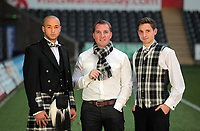 Pictured L-R: Jazz Richards, manager Brendan Rodgers and Joe Allen with welsh tartan outfits, at the Liberty Stadium, Swansea south Wales. Thursday 02 december 2011