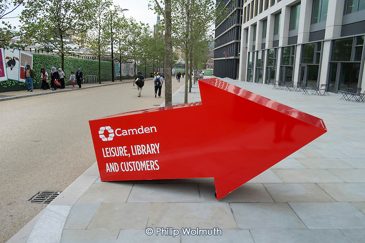 A sign directing residents to Camden Council offices and leisure facilities in a new development behind Kings Cross station, London.