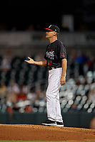 Birmingham Barons manager Omar Vizquel (13) makes a pitching change during a Southern League game against the Chattanooga Lookouts on July 24, 2019 at Regions Field in Birmingham, Alabama.  Chattanooga defeated Birmingham 9-1.  (Mike Janes/Four Seam Images)