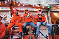 Holland fans drink beer while watching the crowds on the Cape Town fan walk before the 2010 FIFA World Cup semi-final between the Netherlands and Uruguay at Greenpoint Stadium in Cape Town, South Africa on Tuesday, July 6, 2010.  Netherlands defeated Uruguay 3-2.