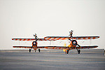 Members of the UK based Breitling Wingwalkers team perform an aerial aerobatic formation with their Stearman Biplanes during the Dubai Airshow on 9 November 2015 at the outskirts of Dubai, United Arab States. Photo by Victor Fraile / Power Sport Images