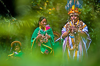 """A shaman from the Kamentsá tribe, accompanied by his family, plays flute during the Carnival of Forgiveness, a traditional indigenous celebration in Sibundoy, Colombia, 12 February 2013. Clestrinye (""""Carnaval del Perdón"""") is a ritual ceremony kept for centuries in the Valley of Sibundoy in Putumayo (the Amazonian department of Colombia), a home to two closely allied indigenous groups, the Inga and Kamentsá. Although the festival has indigenous origins, the Catholic religion elements have been introduced and merged with the shamanistic tradition. Celebrating annually the collaboration, peace and unity between tribes, they believe that anyone who offended anyone may ask for forgiveness this day and all of them should grant pardons."""