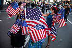 U.S. flags are displayed for sale in Times Square as people gather in celebration after former Vice President Joe Biden was declared the winner of the 2020 presidential election between U.S. President Donald Trump and Biden on November 7, 2020 in New York City.  Photograph by Michael Nagle