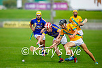Tussle for possession between Ronan Walsh of Kilmoyley and Lixnaw's Jeremy McKenna in round 2 of the County Senior hurling championship