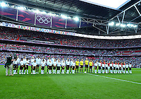 August 09, 2012: USA and Japan Soccer team members and game official pose for a photograph before Women's Football Final match at the Wembley Stadium on day thirteen in Wembley, England. USA defeat Japan 2-1 to win it's third consecutive Olympic gold medal in women's soccer. ..