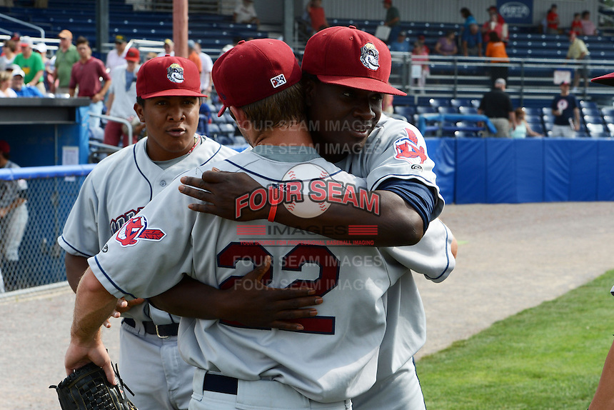 Mahoning Valley Scrappers relief pitcher Kerry Doane (22) is hugged by teammate Alexis Paredes (39) after completing a no-hitter against the Batavia Muckdogs on September 1, 2013 at Dwyer Stadium in Batavia, New York.  Doane went one inning striking out two as the Scrappers pitching duo of Luis Gomez, Carlos Melo, and Doane tossed a no-hitter 6-0 victory over Batavia.  (Mike Janes/Four Seam Images)