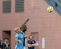 FOXBOROUGH, MA - SEPTEMBER 29: Alexandru Mitrita #28 of New York City FC and Andrew Farrell #2 of New England Revolution battle for head ball during a game between New York City FC and New England Revolution at Gillette Stadium on September 29, 2019 in Foxborough, Massachusetts.