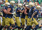Sept. 26, 2015; Quarterback DeShone Kizer celebrates with teammates after he scored a touchdown during the first quarter against the University of Massachusetts. (Photo by Barbara Johnston/University of Notre Dame)
