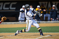 Matthew Oestreicher (20) of the Quinnipiac Bobcats makes contact with the baseball during the game against the Radford Highlanders at David F. Couch Ballpark on March 4, 2017 in Winston-Salem, North Carolina.  The Highlanders defeated the Bobcats 4-0.  (Brian Westerholt/Four Seam Images)