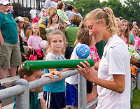 St Louis Athletica midfielder Amanda Cinalli (15) signs autographs for fans after during a WPS match at Anheuser-Busch Soccer Park, in St. Louis, MO, June 7, 2009. Athletica won the match 1-0.