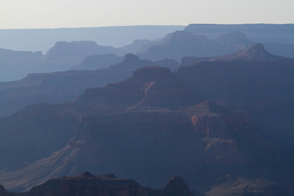 Hazy, backlit day at the South Rim of Grand Canyon National Park, Arizona .  John offers private photo tours in Grand Canyon National Park and throughout Arizona, Utah and Colorado. Year-round.