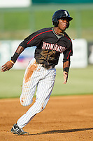 Tim Anderson (2) of the Kannapolis Intimidators hustles towards third base against the Rome Braves at CMC-Northeast Stadium on August 25, 2013 in Kannapolis, North Carolina.  The Intimidators defeated the Braves 9-0.  (Brian Westerholt/Four Seam Images)