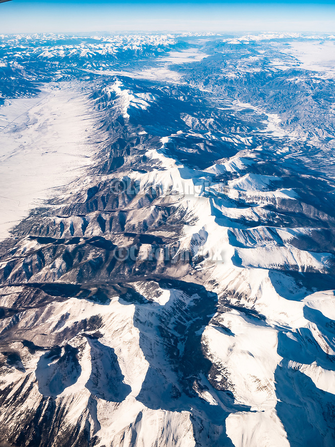 Sangre de Cristo Range and the San Lewis Valley of Colorado with snow, A window seat on a United Airlines flight from Chicago to Los Angeles over America's Flyover County.