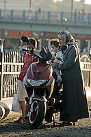 Turkish grandmother with her grandchildren at Karakoy, Istanbul, Turkey
