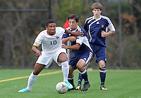 HYATTSVILLE, MD - OCTOBER 26, 2012:  Sean Cowdrey (10) of DeMatha Catholic High School pushes away from Michael Sniezek (3) of St. Albans during a match at Heurich Field in Hyattsville, MD. on October 26. DeMatha won 2-0.