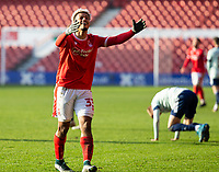9th January 2021; City Ground, Nottinghamshire, Midlands, England; English FA Cup Football, Nottingham Forest versus Cardiff City; Lyle Taylor of Nottingham Forest raises his arms in protest after Referee David Webb gives a free kick