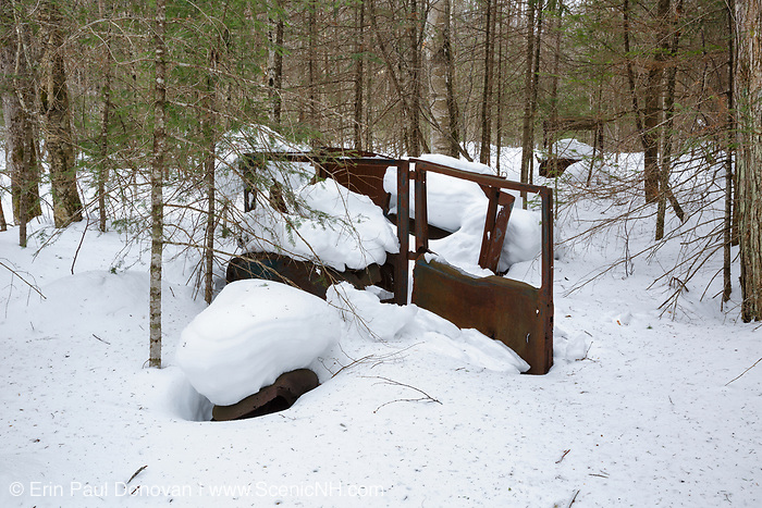 Abandoned car in the Tunnel Brook drainage of Benton, New Hampshire during the winter months. During the 1900s there was a road, connecting Benton and Warren, through Tunnel Brook Notch. And it is believed the road was closed in 1927 because of landslides. This is possibly a 1926 Dodge coupe.