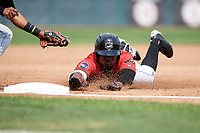Erie SeaWolves left fielder Christin Stewart (35) slides head first into third base during a game against the Akron RubberDucks on August 27, 2017 at UPMC Park in Erie, Pennsylvania.  Akron defeated Erie 6-4.  (Mike Janes/Four Seam Images)