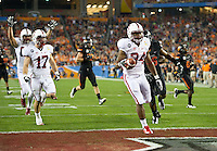 STANFORD, CA - January 2, 2012: Stanford running back Jeremy Stewart (34) scores a touchdown run against Oklahoma State at the Fiesta Bowl at University of Phoenix Stadium in Phoenix, AZ. Final score Oklahoma State wins 41-38.